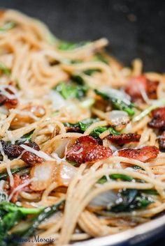 Bacon Spaghetti Florentine is a quick and easy pasta dinner made with spaghetti, bacon, spinach, onions, garlic, and mozzarella, parmesan, and asiago cheese.