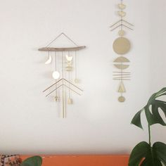 Sister Golden | Naomi Wall Hanging – Catch the sun with this rustic modern wall hanging! Made with hand cut brass, strung with antiqued brass chain.