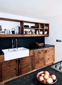 dark wood + black counters #kitchen