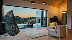 New Zealand's backcountry huts inspired this breezy, open home - Curbedclockmenumore-arrownoyes : Indoor-outdoor living at its finest Accordion Glass Doors, Architecture Résidentielle, Retreat House, Wood Cladding, Beach Cottage Style, Grand Staircase, Indoor Outdoor Living, Tiny House Design, Cabin Homes
