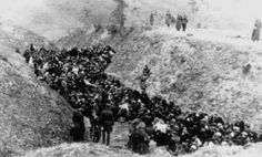 """Jews wait to be murdered.  From the diary of Einsatzkommando member Felix Landau: """"There were hundreds of Jews walking along the street with blood pouring down their faces, holes in their heads, their hands broken and their eyes hanging out of their sockets. They were covered in blood. Some were carrying others who had collapsed. We went to the citadel; there we saw things that few people have ever seen."""""""