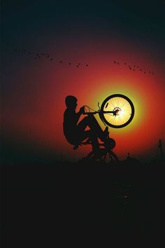Mountain bike tricks in the sunset. Awesome bike photography of this mountain bike rider. http://www.tresna.co.uk
