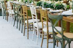 mismatched chairs but matching cushion to tie it all together