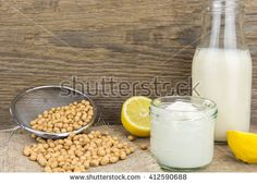 Soy mayonnaise, soy milk, lemon and soybeans, on wooden background