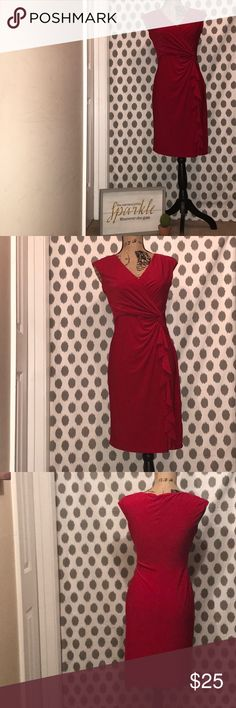 A Lauren Ralph Lauren Red Dress A Lauren Ralph Lauren sexy v-neck, red in color with a twist knot & waterfall effect to the right side of dress. This dress always made me feel like my favorite beauty.....Marilyn Monroe! Lauren Ralph Lauren Dresses Midi