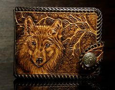 Beautiful mens leather handmade wallet , with a nice hand-tooled wolf, dyed with vegetable dyes and protected with clear finish. High quality natural vegetable-tanned leather. Braided with genuine leather lace. Original clasp-strap with a snap. Inside a roomy compartment for bills, 4 pockets for cards, a large horizontal pocket and a compartment for coins. A nice personal accessory and a perfect gift. Length - 12 cm Height - 10 cm