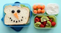 """A snowman sammy, served with snowman """"noses"""" and a colourful fruit salad. Kids will love opening this up on a winter's day at school."""