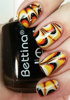 Watermarbled Halloween Nails - I love the look I have yet to get anywhere near to making the attempt actually work though. Anybody have any suggestions on how to marble? Tried it once... ended up a mess...
