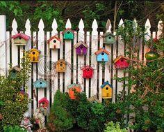 Colourful Bird Houses on the Fence