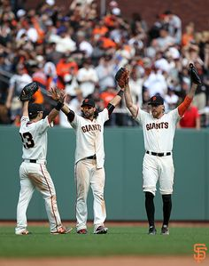 Pence, Pagan, and Aoki celebrate another victory.