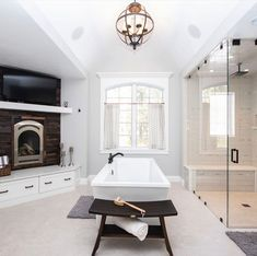 DESIGN TIP: Dark wood accents add organic texture and warmth to a predominately white spa bath. Craig Couture (Cypress Design Co) designed this incredible space using 410 Painted Linen. Linen Cabinet, Cabinet Doors, Bathroom Spa, Master Bathroom, Co Design, Wood Accents, Walk In Shower, Kitchen Remodel, Bathtub