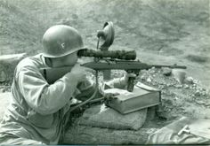 A South Korean soldier aims his M1 carbine fitted with a M3 infrared scope during the Korean War [769 x 540]