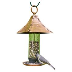 Attract feathered visitors to your garden or backyard with this classic steel bird feeder, showcasing an exaggerated pagoda-style roof and copper finish.