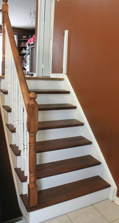 Stairway Remodel Part 4: Painting Spindles, Risers, and Using Polyurethane (Mini-Reveal!) What to buy, how to sand, paint, and apply polyurethane. Check out the other 3 parts to see the full transformation from carpet stairs to hardwood (including finding plywood and pressboard under the carpet.)