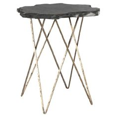 Cut by hand, this end table's natural slate top has an organic, freeform look that immediately draws the eye. An antique hairpin base of hammered brass lends a timeless industrial vibe, making it a perfect accent piece for a loft inspired living area.