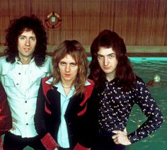 Brian May, Roger Taylor, and John Deacon of Queen.