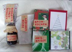 Glühweingelee, Kandierte Zitrusschalen, Baumkuchen-Petit-Fours, Gebrannte Mandeln und Erdnüsse, Anisbaisertaler und ein CD-Kalender inklusive der Rezepte und Weihnachtsmusik