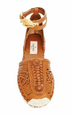 Valentino... but this looks like a Mexican traditional sandal, which is just as original, same materials, and much cheaper.