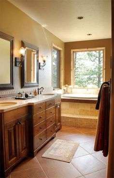 Great his/hers vanity (love those drawers in the middle!) and wonderful whirlpool with a view!