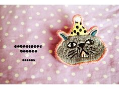 Party cat embroidered brooch.