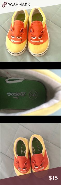 Zootopia shoes size 9 Zootopia Disney yellow shoes size 9 in good condition :) Disney Shoes Sneakers