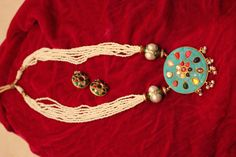 Modern navratan pendant with pearls..