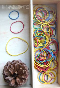 Elastic bands and pine cone finger gym repinned by @PediaStaff – Please Visit ht.ly/63sNt for all our pediatric therapy pins