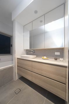 Bulkhead?? with downlight Caesarstone London Grey bathroom countertops. Modern bathroom design ideas.