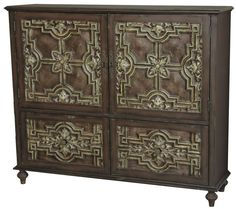 The door and drawer fronts on this ornate credenza were inspired by antique tin ceiling tiles, with their patterns of lattice and leaves. The rubbed finish gives the panels an aged look that can also be found in the complementary hardware.