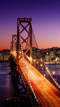 Guide to San Francisco & the Wine Country, California California Itinerary and Travel Guide: The San Francisco skyline and Bay Bridge at sunset.California Itinerary and Travel Guide: The San Francisco skyline and Bay Bridge at sunset. City Wallpaper, Scenery Wallpaper, Bridge Wallpaper, Iphone Wallpaper, Iphone Backgrounds, Wallpaper Backgrounds, San Francisco California, San Francisco Skyline, City Vibe