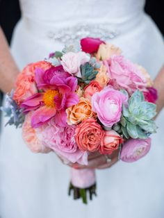 Colorful pink wedding bouquet - featuring ranunculus, peonies, succulents