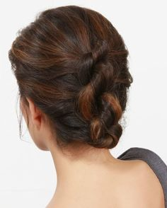 Next time you need a sleek style that's office-appropriate and way easier than it looks, follow Lulu's simple knotty updo tutorial.