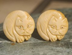 Carved Cat Cabinet Knobs or Drawer Pulls - Bone via Etsy $16 pair from Knucklehead Knobs