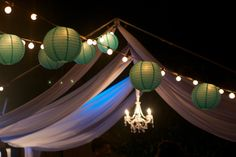 Chandelier in canopy with draping and Tiffany Blue string lighting