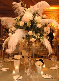 I don't know how they'll feel about the feathers, but the silver vases are a great art deco look.