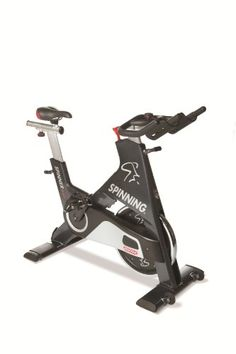 [+] Spinner Blade Commercial Spin Bike Manufactured by Star Trac with Four Spinning DVDs by Mad Dogg