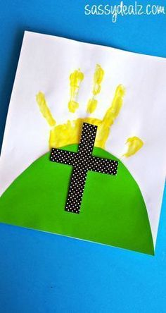 Make a cross craft for Easter! You will need paint, your child's handprint, paper, and glue to make it! It's a great religious art project for kids to do.