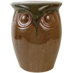 "Ceramic owl plant stand with a gloss finish.    Product: Plant stand    Construction Material: Ceramic    Color: Brown    Features: Weathered finish    Dimensions: 17"" H x 14"" W x 13"" D"