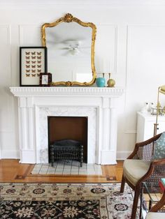 Leigh transformed her dated yellow tile fireplace surround by cutting marble-look adhesive paper into squares and covering the existing tile. The result? An inexpensive update that can be undone if the landlord wants when Leigh moves on.