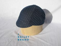 A personal favorite from my Etsy shop https://www.etsy.com/listing/246858526/cycling-cap-indigo-polka-dot-chambray