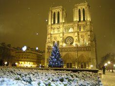 Christmas Eve Mass at Notre Dame de Paris during a white Christmas in Paris
