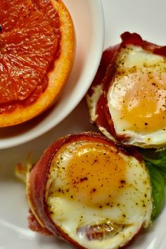 Easy Brunch idea for 6, or 36! Make in muffin tins. Baked Egg Tomato Bacon Cups at reluctantentertainer.com