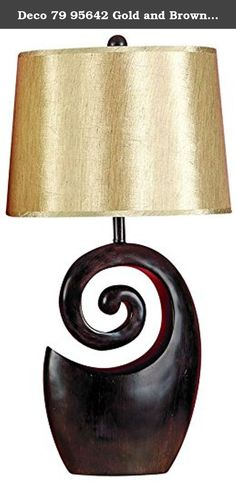 Deco 79 95642 Gold and Brown Polystone Table Lamp. 27 inch contemporary carved spiral base wood look table lamp, gold shimmer hard back drum shade, ball finial. This product is made in China.
