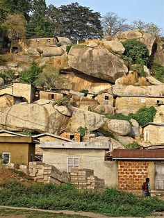 Village in Benin made with more structurally sound buildings. Made in the side of some sort of mountain.