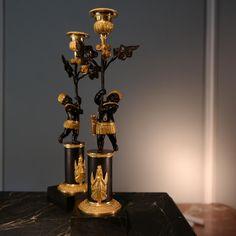 Paire de flambeaux attribuée à Deverberie, époque Empire.