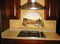 Hand paint a mural or design above your stove-top. Here are some great examples to try above your cooktop. Mural Wall Art, Mural Painting, Murals, Yellow Kitchen Walls, Yellow Kitchens, Kitchen Backsplash, Kitchen Cabinets, Stove, Kitchen Ideas