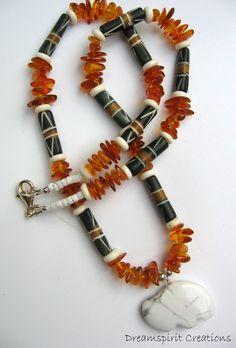 Necklace, amber and decorative bone, buffalo totem pendant
