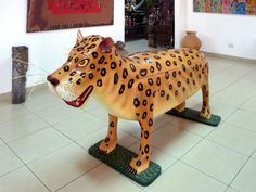 Funerals in Ghana - A handmade Ghanaian fantasy coffin in the shape of a leopard. Photo by David Stanley via Flickr.