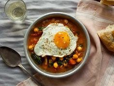 Easy Spanish Chickpea & Spinach Soup with a Fried Egg on top. Perfect winter weeknight meal for when you need to warm up quickly.