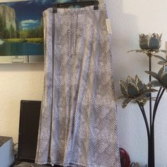 """Only today! NWT. XL SIZE.Black, white, grey.Snake skin design, elastic band at waist,polyester, spandex.Measureament: waist 18"""",36 round,hips 23 1/2 flat,47 round, length 37"""". Michael Kors Skirts Maxi"""